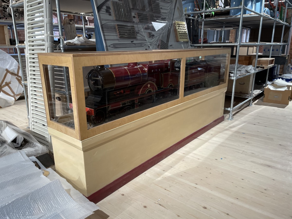 A large and detailed model of a Midland Raillway 'compund' locomotive in a display case