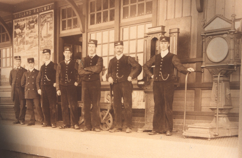 Group of Midland Railway staff on the platform at Wellingborough station